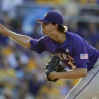 Photo - LSU pitcher Aaron Nola throws in the first inning of an NCAA college baseball regional tournament game against Houston in Baton Rouge, La., Saturday, May 31, 2014. (AP Photo/Gerald Herbert)