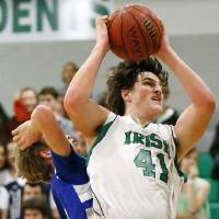 Photo - David Love (41) of Bishop McGuinness grabs a rebound in front of JD Honeycutt (5) of Guthrie during a game between Guthrie and Bishop McGuinness in the McGuinness Classic boys high school basketball tournament at Bishop McGuinness Catholic High School in Oklahoma City, Friday, Jan. 11, 2013. Photo by Nate Billings, The Oklahoman