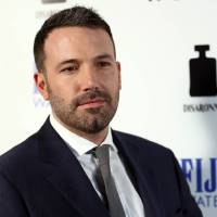 Photo - FILE - In this Tuesday, April 9, 2013 publicity photo provided by Fiji Water, actor Ben Affleck arrives at the premiere of