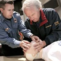 Photo - Right: Lt. Chad Weaver, left, helps Larry Rose, of Edmond, during a CPR class at the Edmond Fire Department during this year's Citizen Fire Academy.  PHOTO BY JOHN CLANTON, OKLAHOMAN ARCHIVE
