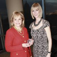 Photo - Gov. Mary Fallin accepts the Oklahoma Leading Lady award from Oklahoma Women's Coalition Executive Director Kristin Davis.  PHOTOS PROVIDED
