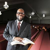 Photo - The Rev. Ray Douglas poses for a picture in the sanctuary of Greater Mount Olive Baptist Church, 1020 NE 42, where he is senior pastor.  Photo by Garett Fisbeck, The Oklahoman