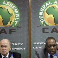 "Photo - FILE - This is a Friday Feb. 10, 2012 file photo of  Confederation of African Football President Issa Hayatou, right, speaks as FIFA President Sepp Blatter, left, looks on during a joint press conference in Libreville, Gabon. FIFA vice president and African football head Issa Hayatou  denied allegations Sunday June 1, 2014  made against him by British newspaper The Sunday Times that he received favors for voting for Qatar to host the 2022 World Cup.  In a statement late Sunday night, the Confederation of African Football called the corruption allegations against its president ""fanciful"" and ""ridiculous.""  (AP Photo/Themba Hadebe, File)"