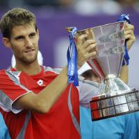 Photo -   Martin Klizan of Slovakia holds his trophy after winning the final match against Fabio Fognini of Italy at the St. Petersburg Open ATP tennis tournament in St.Petersburg, Russia, Sunday, Sept. 23, 2012. (AP Photo/Dmitry Lovetsky)