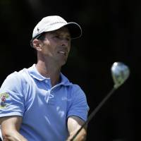 Photo - Mike Weir hits off the first tee during the final round of the Byron Nelson Championship golf tournament, Sunday, May 18, 2014, in Irving, Texas. (AP Photo/Tony Gutierrez)