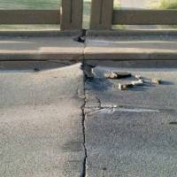 Photo - A bridge on State Highway 33 near downtown Guthrie buckled in the heat Wednesday.  Photo provided by state Transportation Department