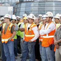 Photo - Construction workers are shown in this September 2011 photo of the Devon Energy Center toping-out ceremony. Photo by Paul B. Southerland, The Oklahoman  PAUL B. SOUTHERLAND