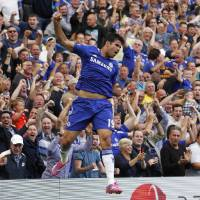 Photo - Chelsea's Diego Costa celebrates his goal against Leicester City during their English Premier League soccer match at Stamford Bridge, London, Saturday, Aug. 23, 2014. (AP Photo/Sang Tan)