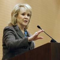 Photo - Gov. Mary Fallin speaks at a May 3 event at the Cox Convention Center in downtown Oklahoma City.   PAUL HELLSTERN - Oklahoman