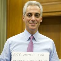 Photo - In this photo provided by the office of the mayor and posted to his Twitter account on Friday, Jan. 11, 2013, Chicago Mayor Rahm Emanuel holds a sign asking,