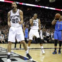 Photo - San Antonio's Manu Ginobili (20) and Tim Duncan react beside Oklahoma City's Russell Westbrook (0) during Game 1 of the Western Conference Finals between the Oklahoma City Thunder and the San Antonio Spurs in the NBA playoffs at the AT&T Center in San Antonio, Texas, Sunday, May 27, 2012. Photo by Bryan Terry, The Oklahoman