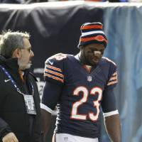 Photo - Chicago Bears wide receiver Devin Hester (23) walks off the field during the first half of an NFL football game against the Minnesota Vikings in Chicago, Sunday, Nov. 25, 2012. (AP Photo/Nam Y. Huh)