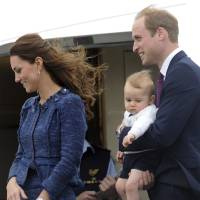 Photo -  Britain's Prince William carries Prince George with Catherine, Duchess of Cambridge as they depart on an RAAF plane bound for Sydney, Wellington, New Zealand, Wednesday, April 16, 2014.  (AP Photo/SNPA, Ross Setford) **NEW ZEALAND OUT**