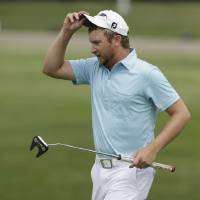 Photo - Brice Garnett take off his cap after sinking his putt on the 18the hole during the second round of the PGA Colonial golf tournament in Fort Worth, Texas, Friday, May 23, 2014. (AP Photo/LM Otero)