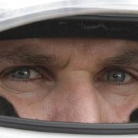Photo - FILE - In this April 28, 2012 file photo, IndyCar driver Will Power, of Australia, looks out from his helmet during a practice session in Sao Paulo, Brazil. On the one-year anniversary of his last victory, Power heads back to Brazil for the Sao Paulo 300, a race he has won every time since it was added to the calendar in 2010.  (AP Photo/Andre Penner, File)