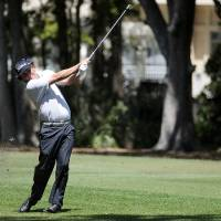 Photo - Jason Dufner hits from the first fairway during the first round of the RBC Heritage golf tournament Thursday, April 18, 2013, in Hilton Head Island, S.C. (AP Photo/The Island Packet, Sarah Welliver)