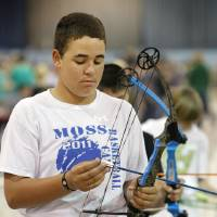 Photo - Seventh Grader R.J. Richmond, age 13 shooting for Moss Public Schools,  prepares to shoot in the 15 meter during the Oklahoma's National Archery in the Schools Program State Shoot at State Fair Park in Oklahoma City Wednesday, March 28, 2012. Photo by Paul B. Southerland, The Oklahoman