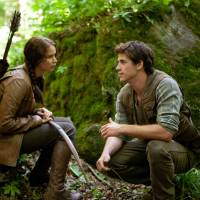 Photo -   In this image released by Lionsgate, Jennifer Lawrence portrays Katniss Everdeen, left, and Liam Hemsworth portrays Gale Hawthorne in a scene from