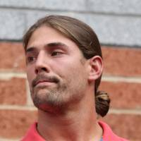 Photo - Philadelphia Eagles wide receiver Riley Cooper meets with the media at NFL football training camp on Wednesday, July 31, 2013, in Philadelphia. Cooper has been fined by the team for making a racial slur at a Kenny Chesney concert that was caught on video, leading him to say he's