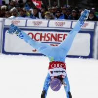Photo - FILE - In this Sunday, March. 17, 2013, file photo, Slovenia's Tina Maze cartwheels after winning the women's alpine skiing giant slalom at the World Cup finals in Lenzerheide, Switzerland. The biggest puzzle in Alpine skiing approaching the Sochi Olympics was working out what happened to Tina Maze. After her historically good 2012-13 season, 11 World Cup wins, record points total, one world championships gold medal , the 30-year-old Slovenian fit perfectly as a potential Winter Games star. Maze celebrated victories with her exuberant trademark, a cartwheeling handspring across the snow. This season, she was clearly unhappy as her winless streak stretched into January, unwilling or unable to explain what she described in her blog as