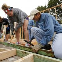 Photo - McKenzie Lannon, Trumbull, Conn., and Rodric Ruggier, Edmond, help frame a house for Joel and Bettie Spears in Bethel Acres. PHOTO BY STEVE SISNEY, THE OKLAHOMAN  STEVE SISNEY