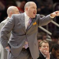 Photo - Marquette's Buzz Williams seems to be a popular early name in the search for OU's next men's basketball coach. AP photo