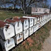 Photo -      Residents of Meadow Ridge Mobile Home Park in Shawnee have been told they have to move out due to elevated uranium levels. A line of mail boxes for the park's residents is seen Wednesday. Photo by David McDaniel, The Oklahoman   David McDaniel -