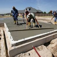 Photo - Workers pour the slab for a home in the Talavera addition west of Santa Fe Avenue and south of SW 164 on Friday. PHOTO BY STEVE SISNEY, THE OKLAHOMAN  STEVE SISNEY - THE OKLAHOMAN