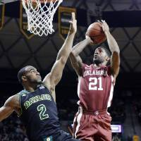 Photo - Oklahoma forward Cameron Clark (21) shoots against Baylor forward Rico Gathers (2) during the first half of an NCAA college basketball game Saturday, Jan. 18, 2014, in Waco, Texas. (AP Photo/LM Otero)
