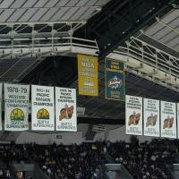 Photo -  While in Seattle, the SuperSonics raised banners for division championships and conference championships.