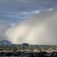 Photo -   A large dust storm, or haboob, sweeps across downtown Phoenix, Saturday afternoon, July 21, 2012. Dust storms are common across Arizona during the summer, and walls of dust more than a mile high can blanket an area in a matter of seconds, sometimes reducing visibility to zero..(AP Photo/Ross D. Franklin)