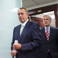 Photo - Speaker of the House John Boehner, R-Ohio, and House Republican leaders emerge from a closed-door strategy session at the Capitol, Wednesday, Sept. 18, 2013. House GOP leaders are looking to reverse course and agree to tea party demands to try to use a vote this week on a must-pass temporary government funding bill to block implementation of President Barack Obama's health care law. Boehner is followed by House Majority Whip Kevin McCarthy, R-Calif. (AP Photo/J. Scott Applewhite)