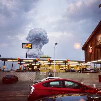 Photo - In this Instagram photo provided by Andy Bartee, a plume of smoke rises from a fertilizer plant fire in West, Texas on Wednesday, April 17, 2013.  An explosion at a fertilizer plant near Waco Wednesday night injured dozens of people and sent flames shooting high into the night sky, leaving the factory a smoldering ruin and causing major damage to surrounding buildings. (AP Photo/Andy Bartee) MANDATORY CREDIT: ANDY BARTEE