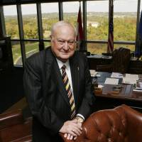 Photo - Pre-Paid Legal Services Founder & CEO Harland Stonecipher poses for a photo in his office at the company headquarters in Ada, OK, Friday, Oct. 16, 2009. By Paul Hellstern, The Oklahoman ORG XMIT: KOD