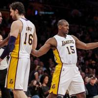 Photo - Los Angeles Lakers forward Metta World Peace points in celebration after scoring during the second half of an NBA basketball game, Sunday, April 15, 2012, in Los Angeles. The Lakers won, 112-108, in overtime. (AP Photo/Bret Hartman) ORG XMIT: CABH112