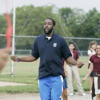 Photo - NBA BASKETBALL / THUNDER FIT CLINIC: Oklahoma City Thunder's James Harden visited with students from Belle Isle Enterprise Middle School for this season's first Thunder Fit drill Thurs. Sept. 10, 2009. Photo by Jaconna Aguirre, The Oklahoman. ORG XMIT: KOD
