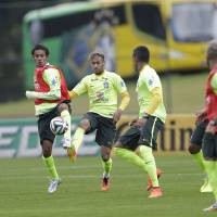 Photo - Brazil's Neymar. center, practices during a training session at the Granja Comary training center in Teresopolis, Brazil, Friday, June 20, 2014. Brazil plays in group A of the 2014 soccer World Cup. (AP Photo/Andre Penner)