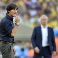 Photo - Germany's head coach Joachim Loew, left,  and France's head coach Didier Deschamps stand on the touchline during the World Cup quarterfinal soccer match between Germany and France at the Maracana Stadium in Rio de Janeiro, Brazil, Friday, July 4, 2014. (AP Photo/Martin Meissner)