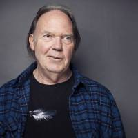 Photo -   This Sept. 27, 2012 photo shows singer-songwriter Neil Young posing for a portrait at The Carlyle hotel in New York. Young has released his first book, a memoir titled,