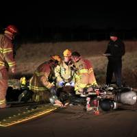 Photo - Edmond firefighters train after dark, responding to a vehicle accident scenario. Photo by Sarah Phipps, The Oklahoman  SARAH PHIPPS - SARAH PHIPPS
