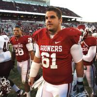 Photo - Oklahoma's Ben Habern (61) leaves the field following the college football game where the Texas A&M Aggies were defeated by the University of Oklahoma Sooners (OU) 41-25 at Gaylord Family-Oklahoma Memorial Stadium on Saturday, Nov. 5, 2011, in Norman, Okla. Photo by Steve Sisney, The Oklahoman ORG XMIT: KOD