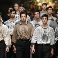 Photo - A model wears a creation of Dolce & Gabbana men's Fall-Winter 2013-14 collection, part of the Milan Fashion Week, unveiled in Milan, Italy, Saturday, Jan. 12, 2013. (AP Photo/Antonio Calanni)