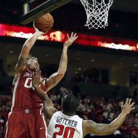 Photo - Oklahoma's Ryan Spangler shoots under pressure from Texas Tech's Toddrick Gotcher (20) during an NCAA college basketball game in Lubbock, Texas, Saturday, Jan. 25, 2014. (AP Photo/The Avalanche-Journal, Tori Eichberger)