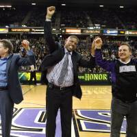 Photo - FILE - In this Feb. 28, 2012, file photo, Sacramento Mayor Kevin Johnson, center, celebrates a tentative agreement to build a new arena and keep with the in Sacramento, Calif., with Sacramento Kings owners Joe, left, and Gavin Maloof, right, during a timeout in an NBA basketball game in Sacramento, Calif.  After backing out of the deal to build a new arena in Sacramento and announcing the sale of the Kings to a group that wants to move the team to Seattle, the brothers have become the city's most-reviled villains heading into a preliminary NBA meeting on the issue Wednesday, April 3, 2013, in New York. (AP Photo/Steve Yeater, File)