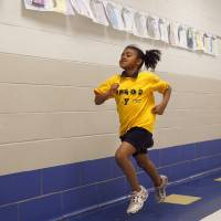Photo - Mykal Ogans runs with the girls running club at Martin Luther King Elementary in Oklahoma City.Photo by Sarah Phipps, The Oklahoman  SARAH PHIPPS - SARAH PHIPPS