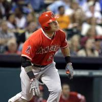 Photo - Los Angeles Angels' Josh Hamilton watches the ball go over the wall for a two-run home run against the Houston Astros in the fifth inning of a baseball game on Saturday, April 5, 2014, in Houston. (AP Photo/Pat Sullivan)