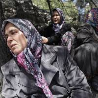 Photo - Relatives of miners wait near a coal mine in Soma, western Turkey, Thursday, May 15, 2014. An explosion and fire at the coal mine in Soma, some 250 kilometers (155 miles) south of Istanbul, killed hundreds of workers, authorities said, in one of the worst mining disasters in Turkish history. (AP Photo/Lefteris Pitarakis)