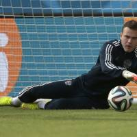 Photo - Goalkeeper Igor Akinfeev catches a ball the Russian national soccer team training session at the Maracana stadium in Rio de Janeiro, Brazil, on Saturday, June 21, 2014. Russia will play next game against Belgium in group H of the 2014 soccer World Cup. (AP Photo/Ivan Sekretarev)
