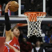 Photo -   Los Angeles Clippers' Blake Griffin (32) goes up over Atlanta Hawks' Zaza Pachulia (27) in the first half of an NBA basketball game at Philips Arena in Atlanta, Saturday, Nov. 24, 2012. (AP Photo/David Tulis)