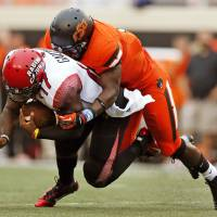 Photo - OSU's Daytawion Lowe (8) sacks ULL quarterback Blaine Gautier (17) in the first quarter during a college football game between Oklahoma State University and the University of Louisiana-Lafayette at Boone Pickens Stadium in Stillwater, Okla., Saturday, Sept. 15, 2012. Photo by Nate Billings, The Oklahoman